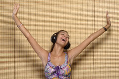 Beautiful woman enjoying music Stock Image