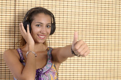 Beautiful woman enjoying music Royalty Free Stock Photography