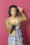 Beautiful woman enjoying music Stock Photo