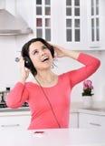 Beautiful woman enjoying music stock image