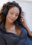 Beautiful woman enjoying music eyes closed royalty free stock images
