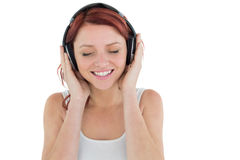 Beautiful woman enjoying music through headphones Royalty Free Stock Photo