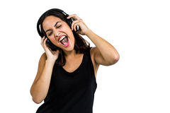 Beautiful woman enjoying music through headphones Royalty Free Stock Images