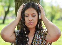 Beautiful woman enjoying music outdoors Royalty Free Stock Photos