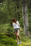 Beautiful woman enjoying nature in forest green Stock Image