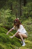 Beautiful woman enjoying nature in forest green Stock Photos