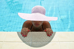 Beautiful woman enjoying at pool Stock Photos