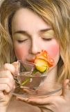 Beautiful woman enjoying the rose and water Royalty Free Stock Photos