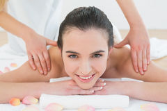 Beautiful woman enjoying shoulder massage at beauty spa Royalty Free Stock Image