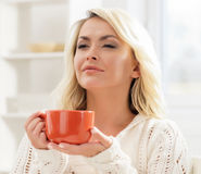Beautiful woman enjoying the smell of coffee in the morning Royalty Free Stock Photo