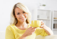Beautiful woman enjoying the smell of coffee Stock Photography