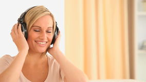Beautiful woman enjoying some music stock video