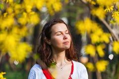 Beautiful woman enjoying spring sun. Beautiful young woman enjoying spring sun with eyes closed Stock Photos