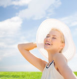 Beautiful woman enjoying summer outdoors Stock Image
