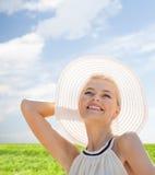 Beautiful woman enjoying summer outdoors Stock Photography