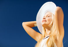 Beautiful woman enjoying summer outdoors Royalty Free Stock Photo