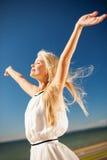 Beautiful woman enjoying summer outdoors Stock Photos