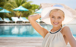 Beautiful woman enjoying summer over beach. People, summer holidays, travel, tourism and vacation concept - beautiful woman in sun hat enjoying summer outdoors Royalty Free Stock Photo
