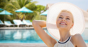 Beautiful woman enjoying summer over beach. People, summer holidays, travel, tourism and vacation concept - beautiful woman in sun hat enjoying summer outdoors Stock Photo