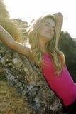 Beautiful woman enjoying the sun. On the mountain Royalty Free Stock Image