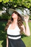 Beautiful woman enjoying the sun in the park Stock Photo
