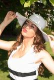 Beautiful woman enjoying the sun in the park Royalty Free Stock Photo