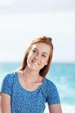 Beautiful woman enjoying the sun at the sea Stock Photos