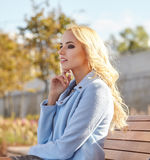 Beautiful woman enjoying the sunny autumn day Stock Photography