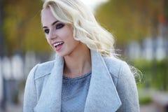 Beautiful woman enjoying the sunny autumn day Stock Photo