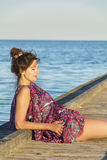 Beautiful woman enjoying the sunset sun  on the beach Royalty Free Stock Photography