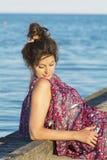 Beautiful woman enjoying the sunset sun  on the beach Royalty Free Stock Photos