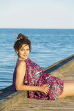 Beautiful woman enjoying the sunset sun  on the beach Royalty Free Stock Image