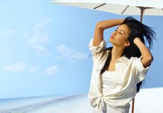 Beautiful woman enjoying sunshine. Beautiful young woman enjoying sunshine and summer holiday on the beach Stock Images