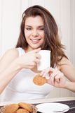 Beautiful woman enjoying tea and cookies Royalty Free Stock Image