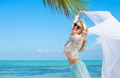 Beautiful woman enjoying vacation in tropical destination Stock Photos