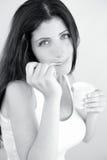 Beautiful woman enjoying white yogurt black and white portrait Royalty Free Stock Photography