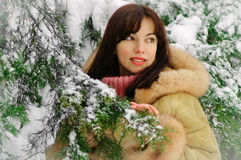 Beautiful woman enjoying winter snow Royalty Free Stock Photos