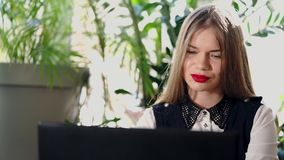 A beautiful woman enjoys the letters from fans who wrote on the laptop`s e-mail stock footage