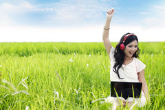 Beautiful woman enjoys the summer day Stock Photography