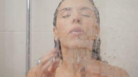 Beautiful woman enjoys of taking hot shower stock video