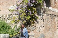 Beautiful woman at European garden royalty free stock photography
