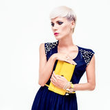 Beautiful woman in an evening dress with a clutch Stock Photography