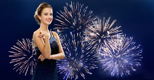 Beautiful woman in evening dress over firework Royalty Free Stock Photos
