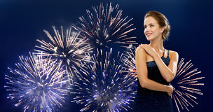 Beautiful woman in evening dress over firework Stock Photography