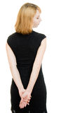Beautiful woman in evening dress turned her back Royalty Free Stock Photography