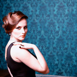 Beautiful woman with evening dress in vintage room Royalty Free Stock Photos