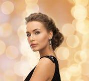 Beautiful woman in evening dress wearing earrings Stock Photos