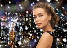 Beautiful woman in evening dress wearing earrings Stock Photo
