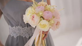 Beautiful woman in evening dress with wedding bouquet. stock footage