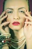 Beautiful woman with evening make-up. Stock Photos